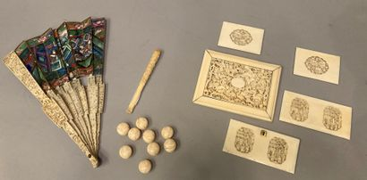 Ivory set consisting of a fan, buttons, umbrella...
