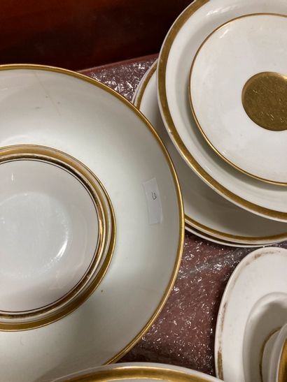 Lot of white and gold porcelain including cups, teapot, cups on pedestal, plates,...