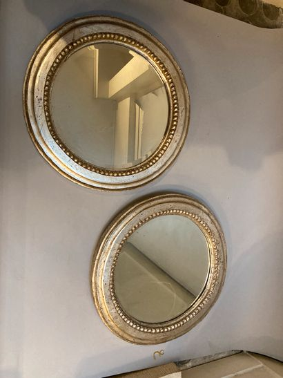 Pair of silver plated wooden circular mirrors...