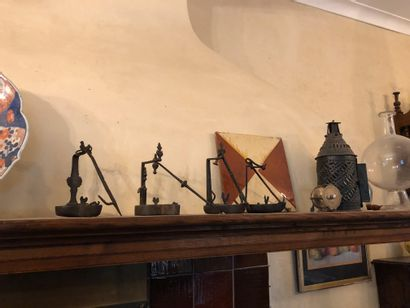 Handle of various trinkets made of wrought iron, tin and sheet metal including torches,...