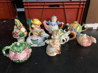Lot of teapots with animal decoration and fruits and vegetables  sold as is