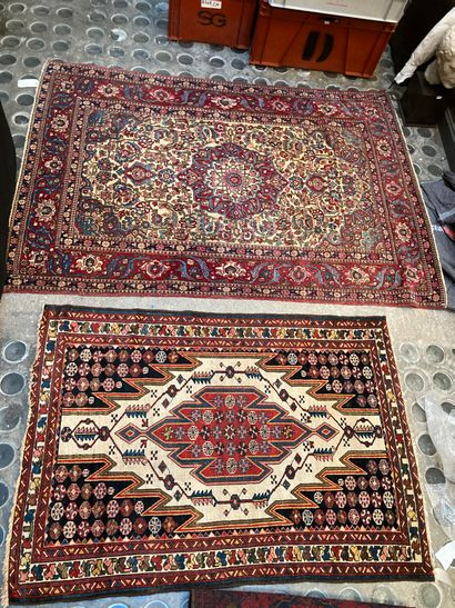 Set of two Persian carpets on cream background,...