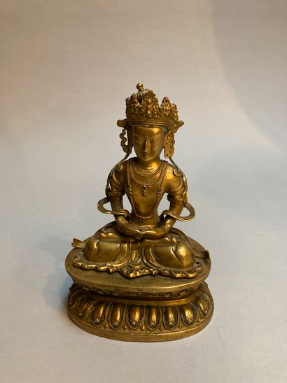 Buddha in copper with inlaid decoration...