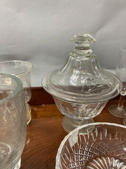 Large lot of glassware including vases, glasses, salad bowl, ice cube bucket, champagne...