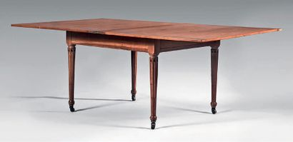 The table is rectangular in shape, the swivel...
