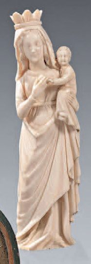 Carved ivory statuette representing the Virgin...