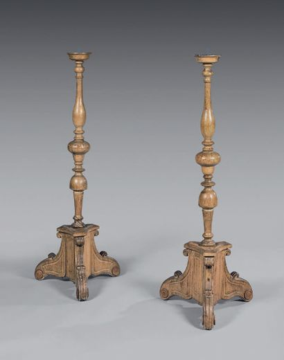A pair of turned or carved oak picnic tables...