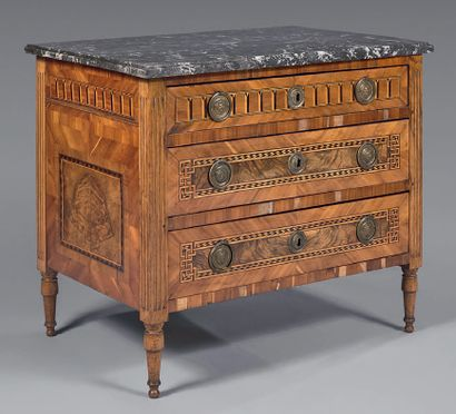 A small chest of drawers inlaid with walnut...
