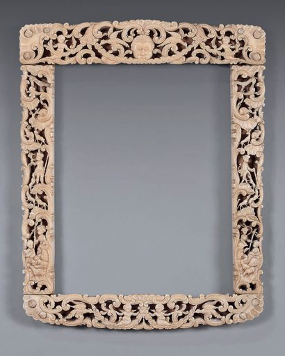 Ivory frame finely carved and pierced with...
