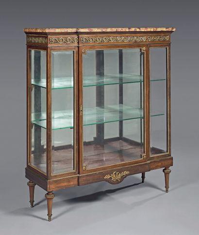 Mahogany and mahogany veneer showcase; the...