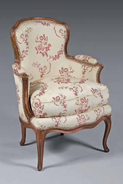 Molded beech armchair with a sinuous cabriolet...