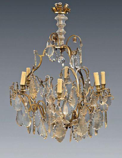Lustre dit «cage» à quinze lumières en bronze...