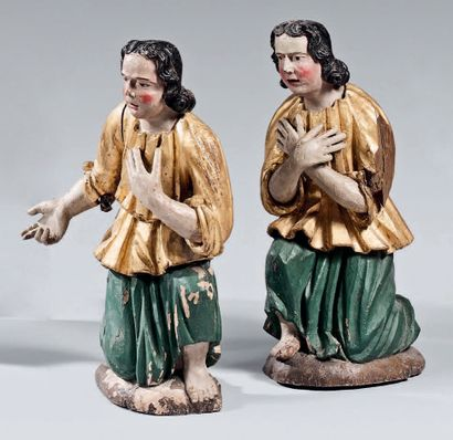Pair of imploring angels in gilded and polychrome...