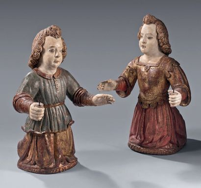 Pair of carved, gilded and lacquered wooden...