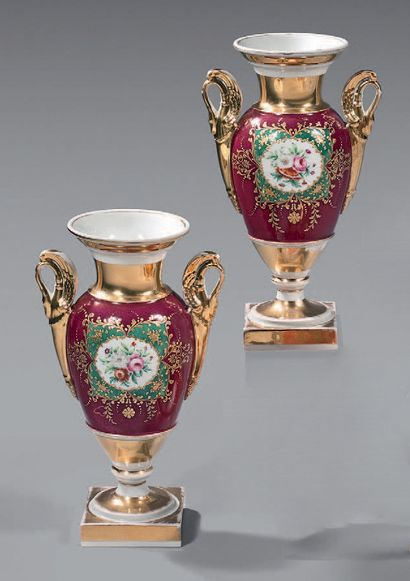 A pair of porcelain vases of Paris with...