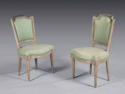 Pair of moulded, carved and relacquered cream...