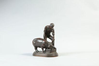 Isidore BONHEUR (1822-1901). Homme nourrissant un cochon. Bronze à patine brune...