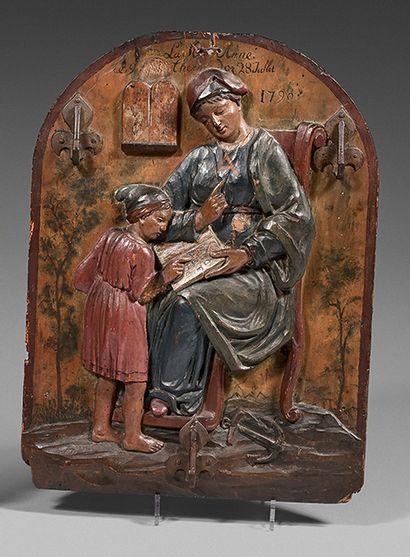 Plaque en bois peinte et sculptée en relief...