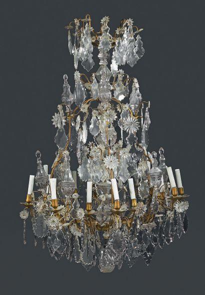 Lustre dit «cage» à seize lumières en bronze...