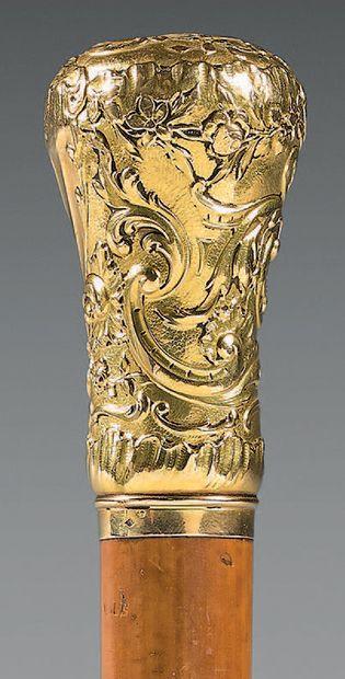 Pommeau de canne en or, de style Louis XV...