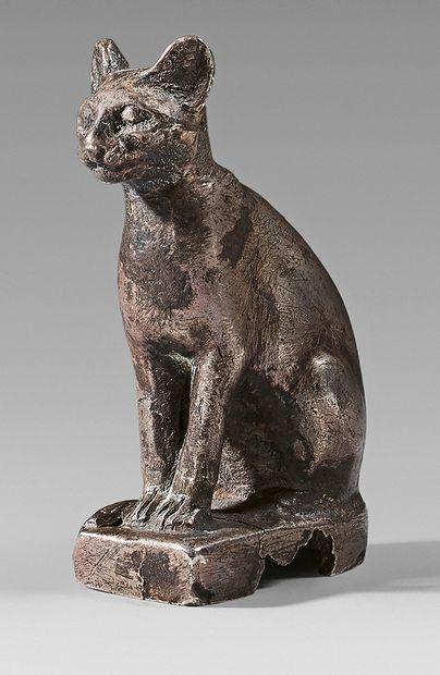 Statuette de chatte Bastet assise, la queue...