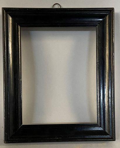 Cadre en bois mouluré et noirci  XIXème  18...