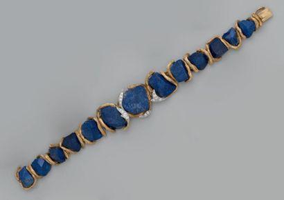 Beau bracelet articulé, composé de motifs...