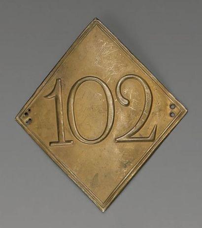Plaque de shako losangée du 102e régiment...