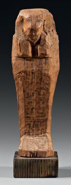 Rare chaouabti momiforme présentant une perruque...