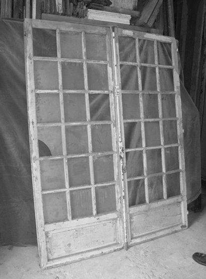 2 Portes fenêtres vitrées en chêne H. 210...
