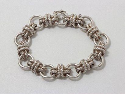 Bracelet en argent, composé d'anneaux reliés...