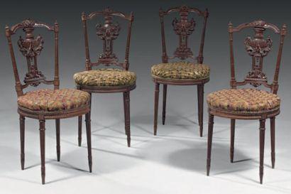 Suite de quatre chaises en palissandre, le...