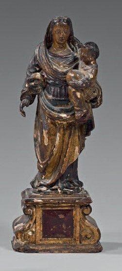 Vierge à l'enfant en bois sculpté, doré et...