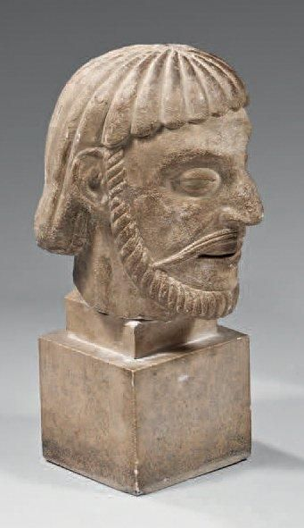 Grande tête d'homme décorative en pierre...