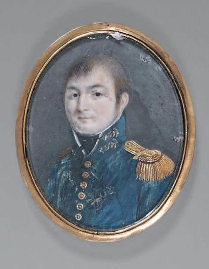 Miniature ovale sur ivoire: Portrait d'un lieutenant de vaisseau en habit bleu,...