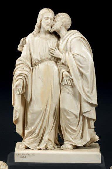 Groupe en ivoire finement sculpté représentant...