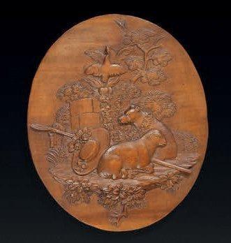 Médaillon ovale sculpté en bas-relief des...