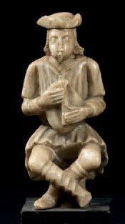 Statuette en albâtre représentant un joueur...