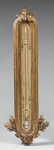 Baromètre à mercure dans un cadre en bois...