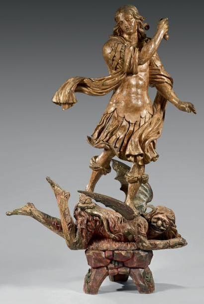 Saint Michel terrassant le demon en bois...