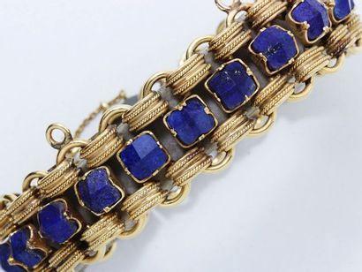 Bracelet en or 18 K, composé de maillons...