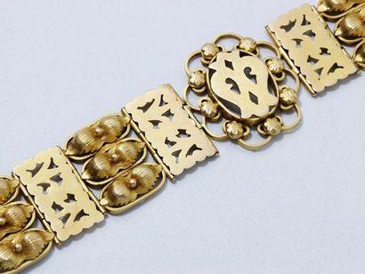 Bracelet articulé en or 18 K, composé de...