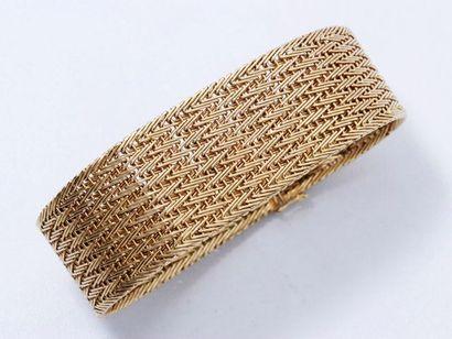 Bracelet souple en or 18 K tressé, agrémenté...