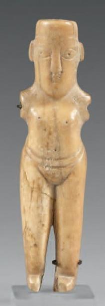 Figurine féminine stylisée (poupée?), les...