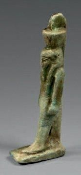 Amulette de Néfertoum marchant Faïence verte...