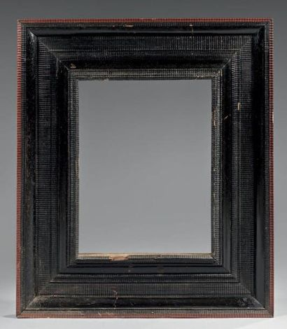 Cadre en bois teinté noir, partiellement...