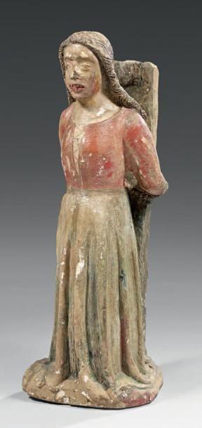 Sainte Apolline en pierre polychrome sculptée...