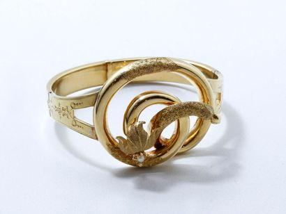 Bracelet rigide ouvrant en or 18 K à charnières,...