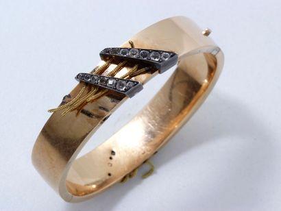 Bracelet jonc ouvrant en or 18 K, rehaussé...