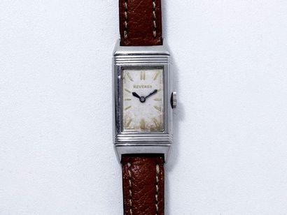 REVERSO Montre bracelet de dame en acier, cadran ivoire légèrement tâché avec index...